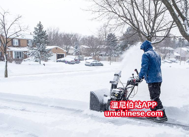 man-removing-snow-with-a-snowb-81683711.jpg